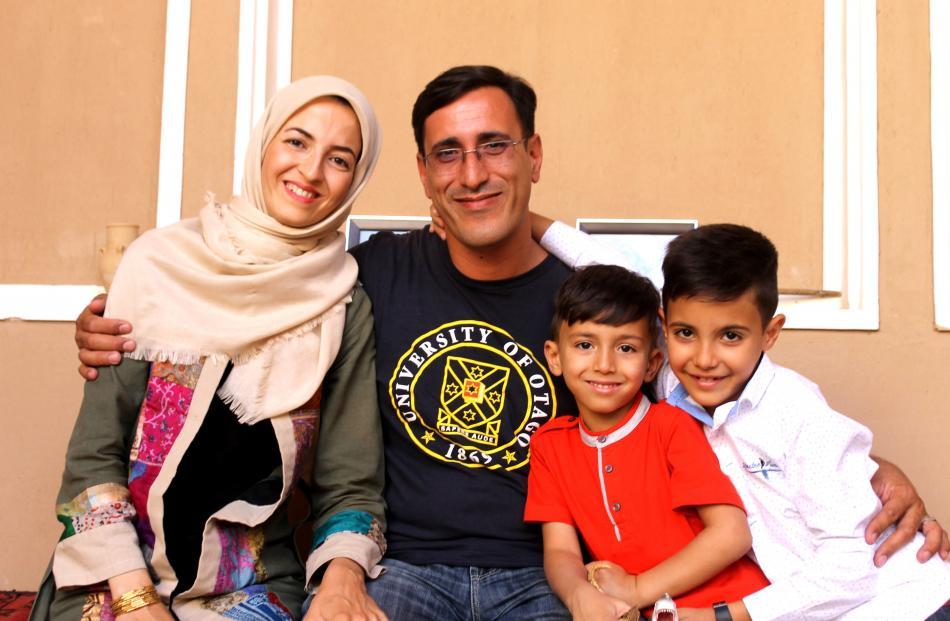 Ms Leili Ghanbari, Dr Ali Falahati, and sons Aryan and Nima at home in Yazd. Photos: Diana Noonan.
