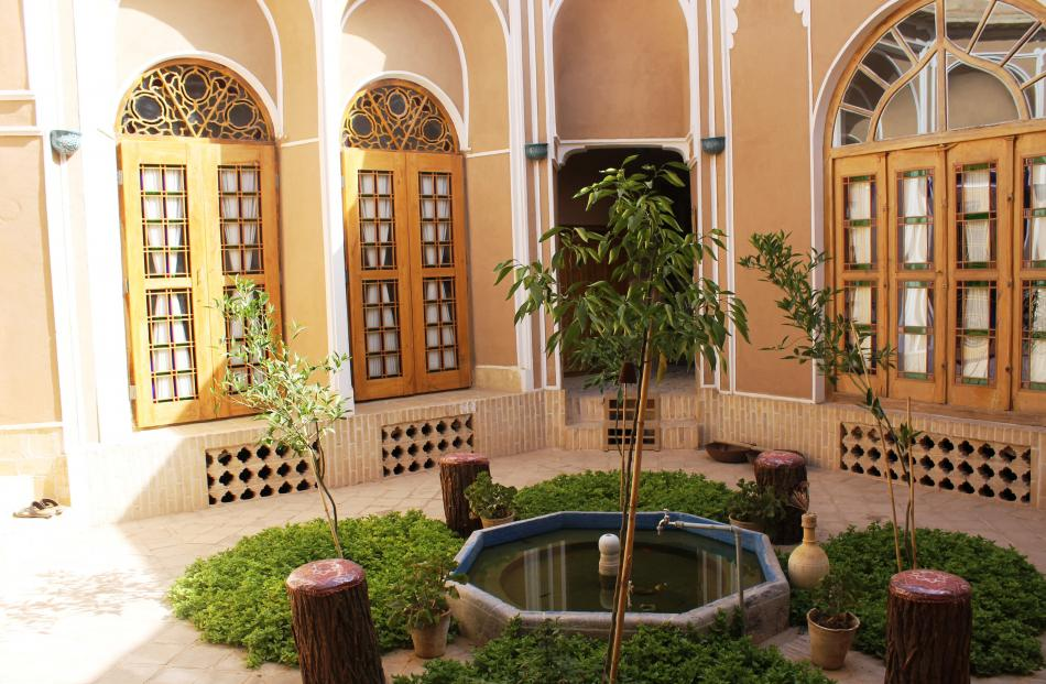 The courtyard of Ms Ghanbari and Dr Falahati's Narenjestan traditional guesthouse in old Yazd.
