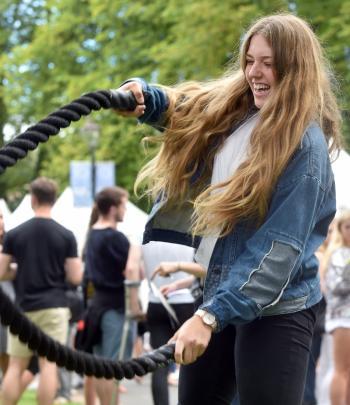 Lucy Edwards (18) tries the battle ropes at the OUSA tent city.