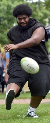 Rokola Lasei (20) kicks a ball around on the Museum Reserve yesterday.