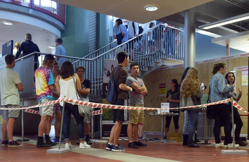 Students wait for identification cards at the University of Otago yesterday.