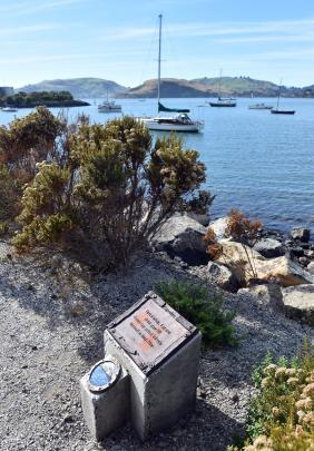 Eleven poetry tiles and accompanying image tiles have been positioned along the edge of Peninsula...