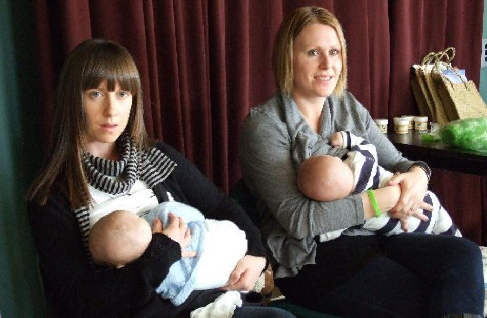 At the Alexandra Big Latch On are Megan Breese (left), of Clyde, with son Aden Tippet (3 months)...