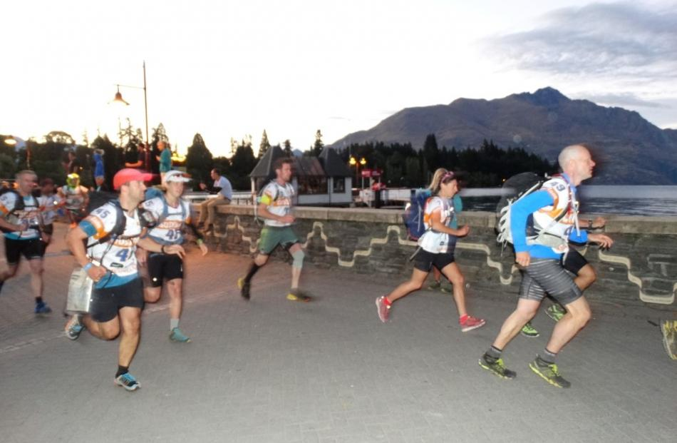 Godzone competitors pound the pavement, usually clogged with tourists, along Queenstown Bay this...