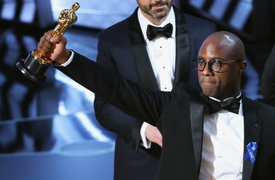 "Director Barry Jenkins holds the Oscar as Moonlight wins Best Picture after ""La La Land"" was mistakenly announced as the winner. Photo: Reuters"