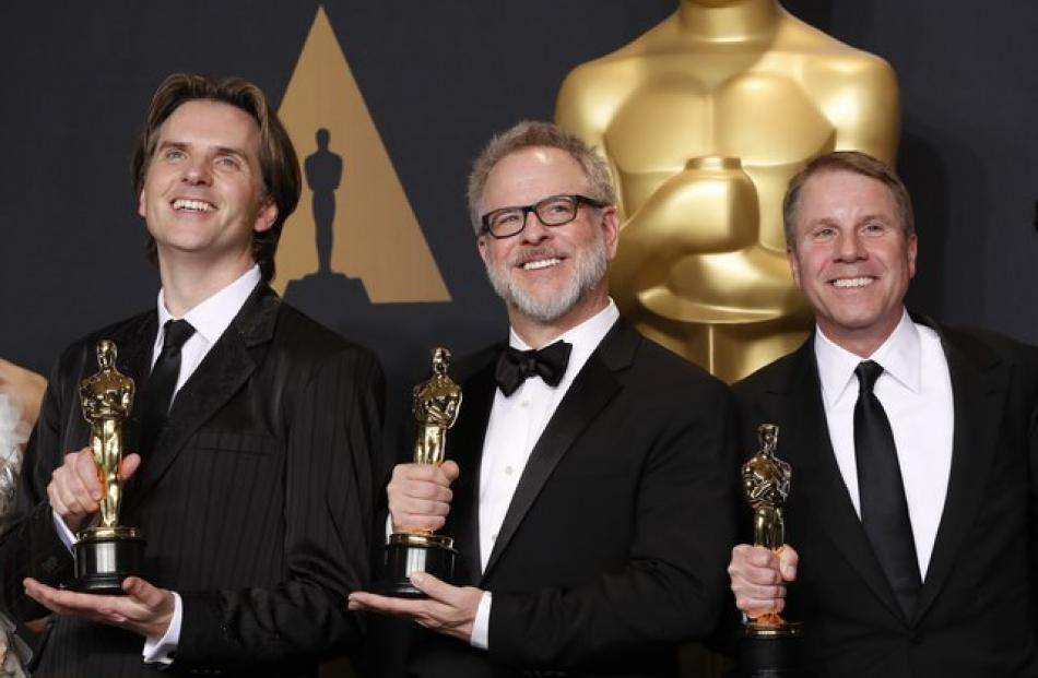 "Byron Howard, Rich Moore and Clark Spencer winners of Best Animated Feature Film for ""Zootopia"". Photo: Reuters"