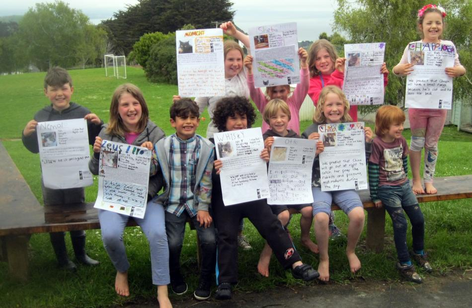 Pupils at Purakaunui School with their cat posters.
