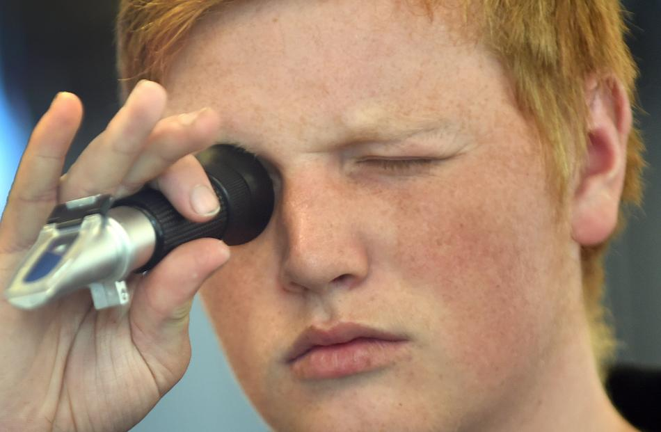 Cody Keen, of Tokomairiro High School, looks through a refractometer.  Photos: Peter McIntosh.