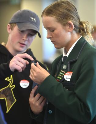 Matt Sinclair (15), of South Otago High School, and Hannah Rogers (16), of Columba College, check...
