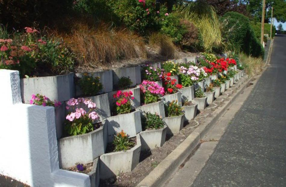 Nancy Graham has found a lovely way to decorate a V block retaining wall built by her husband,...