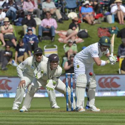 Dean Elgar bats for South Africa as Black Caps BJ Watling and Ross Taylor 