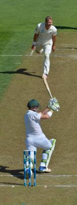 Wagner watches as Proteas' Dean Elgar clips the ball to the boundary for 4.