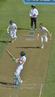 Jimmy Neeshan of New Zealand watches South African captain Faf du Plessis get caught in the...