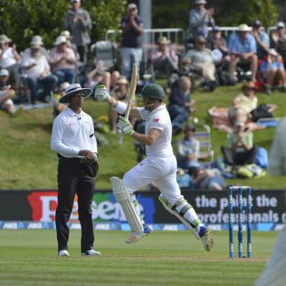 South Africa's Dean Elgar celebrates his century against New Zealand.