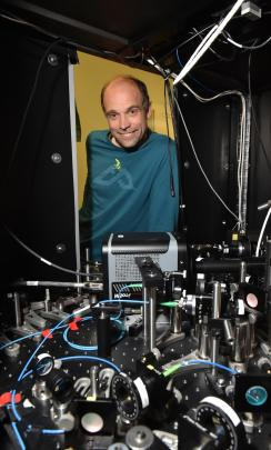 University of Otago researcher Dr Mikkel Andersen with the machine that helped him and fellow researchers control an individual atom. Photos by Gregor Richardson.