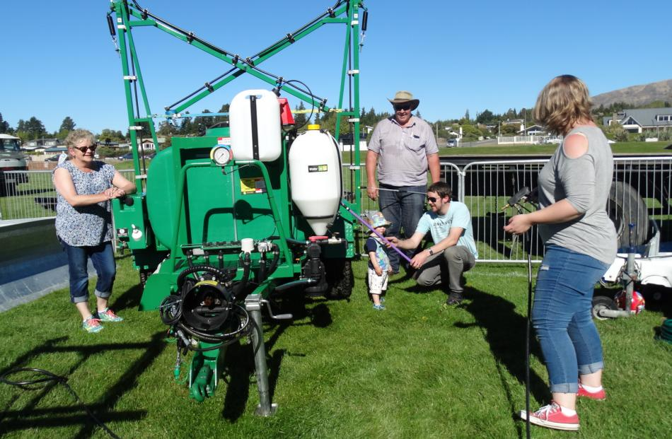 Dianne (left) and David Ensor (second from left), of Gore, and their son Kade Ensor and his wife Hayley, of Dunedin, introduce the younger Ensors' son Arthur (20 months) to the family farm machinery business.