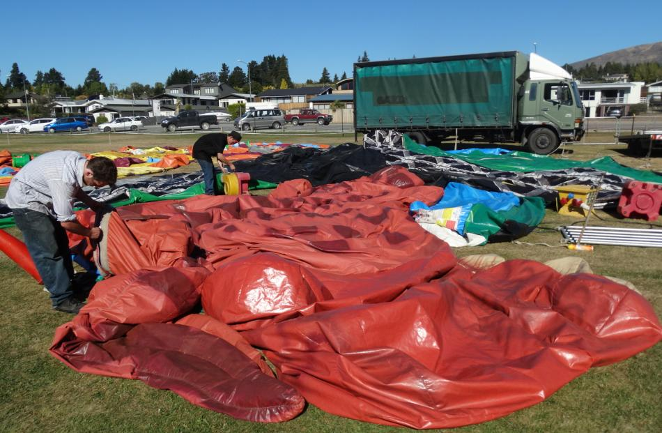 Inflating the King Kong and dinosaur slide for the Wanaka A&P Show are Max Campbell (left), of Dunedin, and Ramene Fisher, of Invercargill. Photos by Kerrie Waterworth.