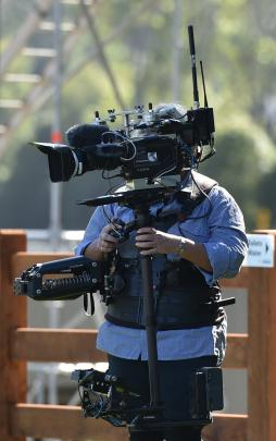 Camera operators keep tabs on events at the University of Otago Oval this week. Photos: Gregor...