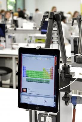 Each new lab station includes an iPad, on which the students will be able to complete tests and...