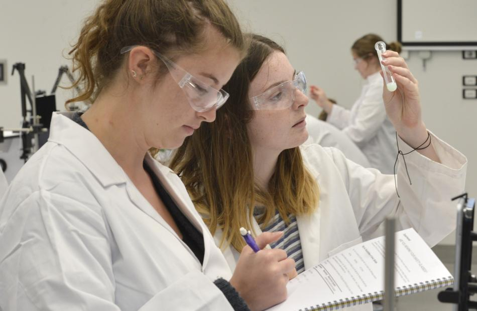 First-year students Claire Norbitt (18, left) and Annie Howie (18) use the new lab equipment.