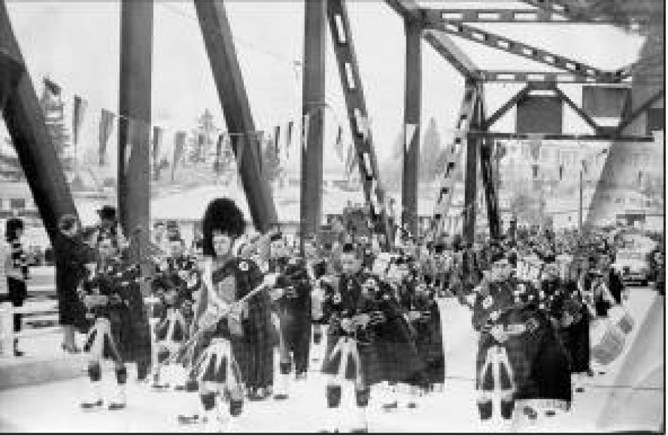The big day: The Alexandra Pipe Band leads the procession for the opening of the Alexandra Bridge...