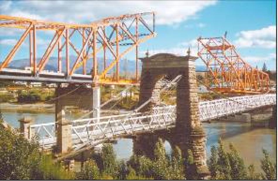 Make way: Construction work begins on the new bridge alongside the original bridge, which was...