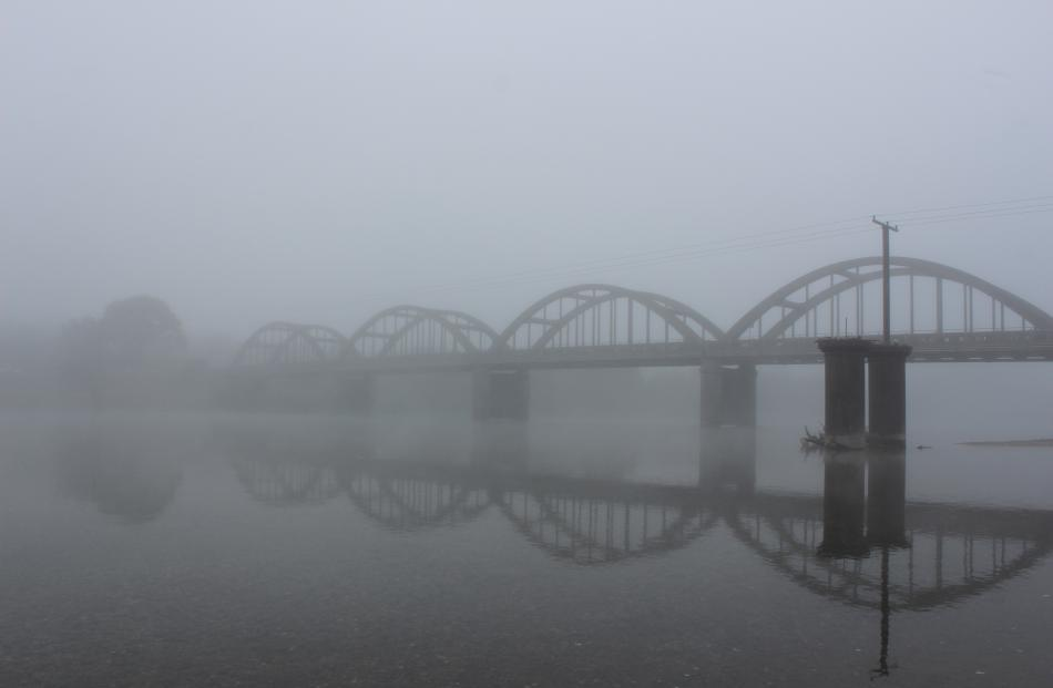 The Balclutha bridge, reflected in the Clutha River, is  shrouded in mist yesterday morning....