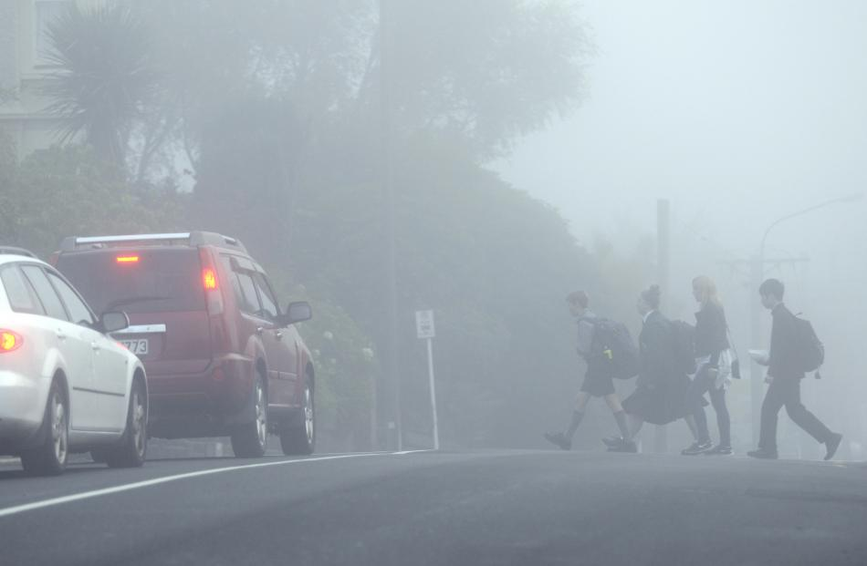 Pupils cross Highgate on their way to school yesterday morning.