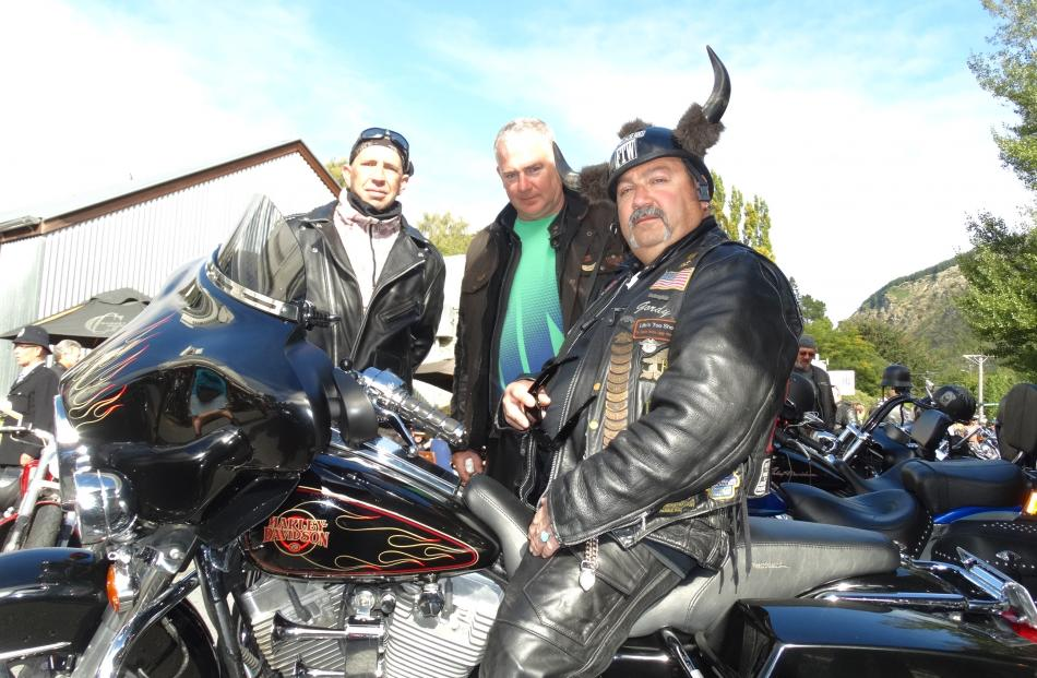 Bronx Gordo, of the US, on his Harley-Davidson 2000 Electroglide, with Shawn Stapleton (left), of...