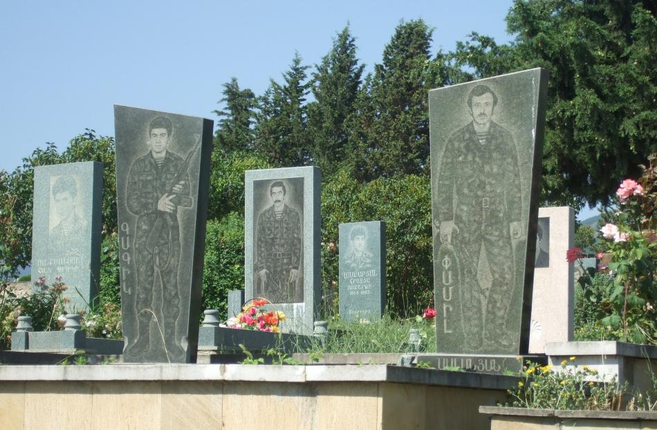 Life-size headstones of soldiers' graves in the National War Cemetery.