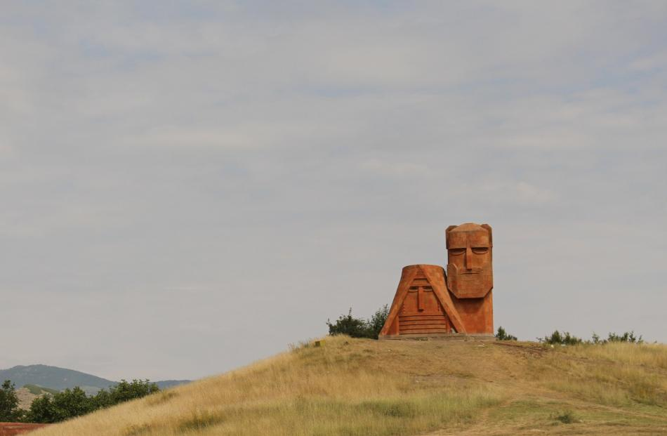A symbol of Armenian heritage, the ''We Are Our Mountains'' sandstone monument stands on a hill...