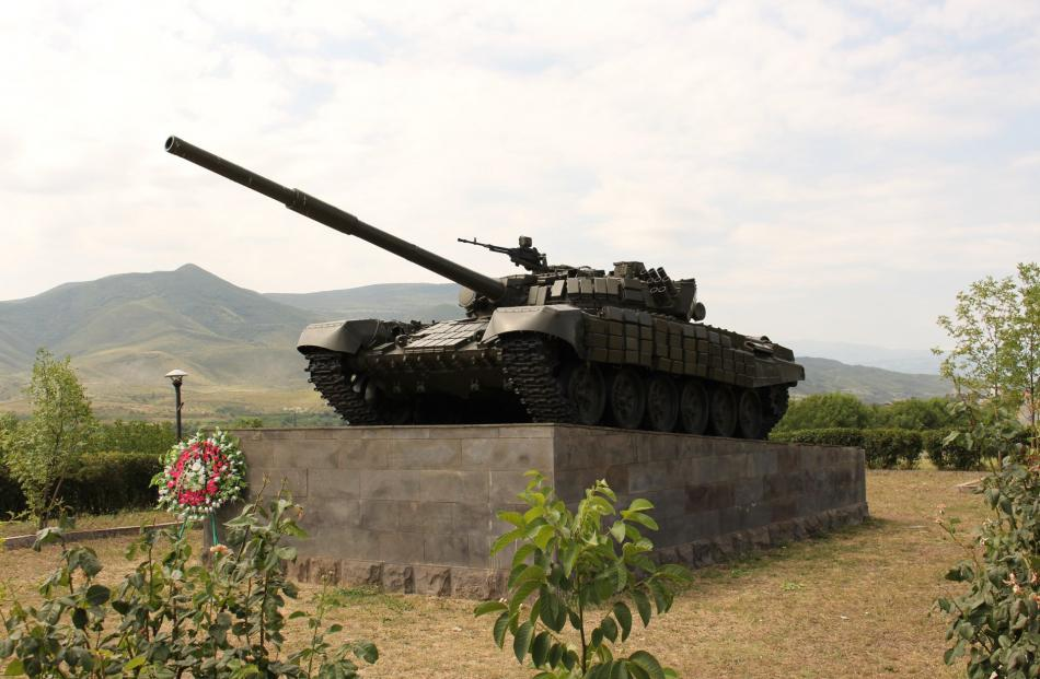 A tank with its gun pointing towards Azerbaijan is a monument to war in Nagorno Karabakh.PHOTOS:...