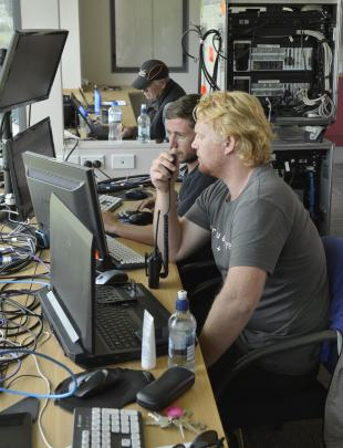 Part of the Virtual Eye technology team in the media centre at the University Oval yesterday are...