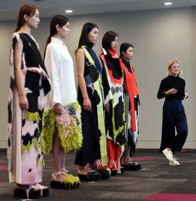 Natalie Vladimiroff explains her designs to the judges.