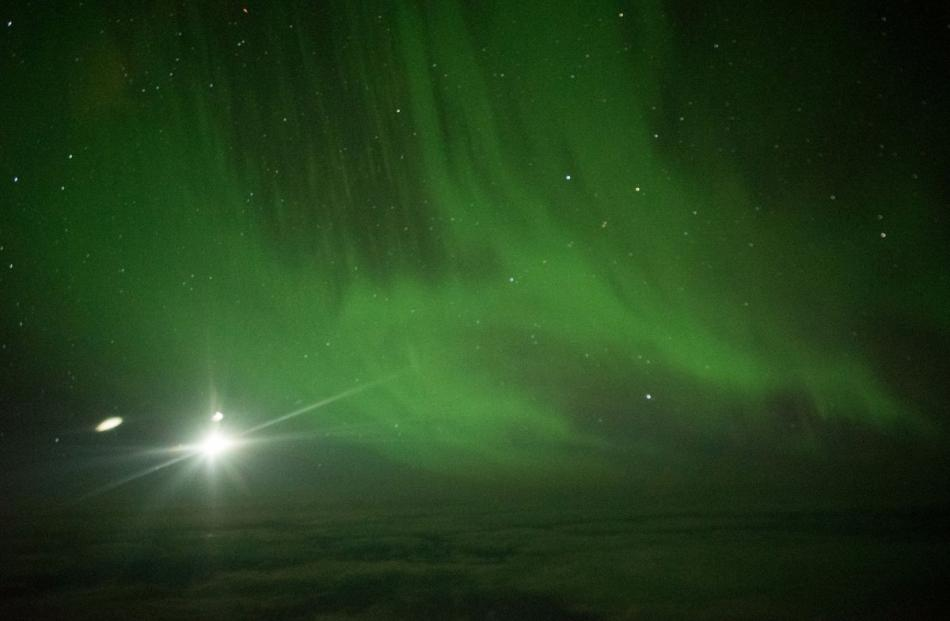 The moon is visible with an aurora at 60deg south of the equator. Photo: Ian Griffin.