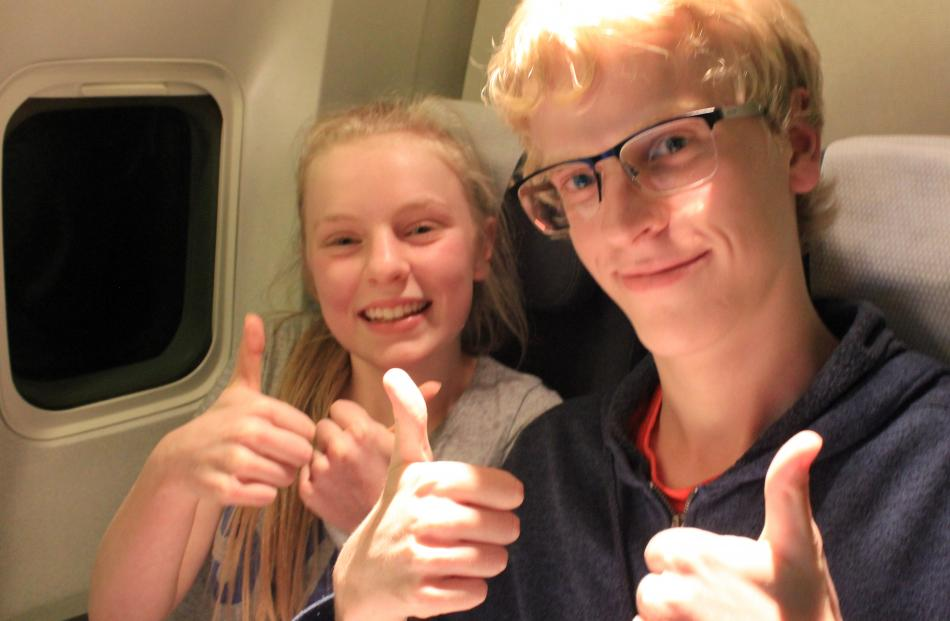 Harriet (14, left) and Elliot (18, right) Cottle, of Dunedin, on board flight NZ1980, bound for...