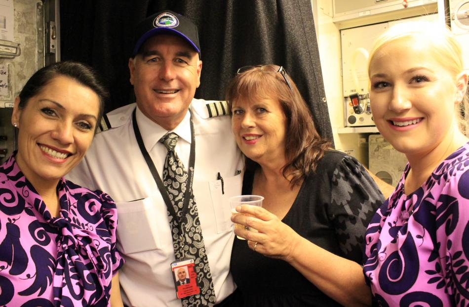 Frith Walker celebrates her birthday, quietly, with Air New Zealand crew (from left) Donna...