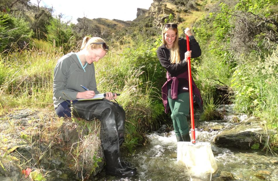 Bryony Alden and Skye Anderson in a tributary of the Shotover River on Coronet Peak Station.