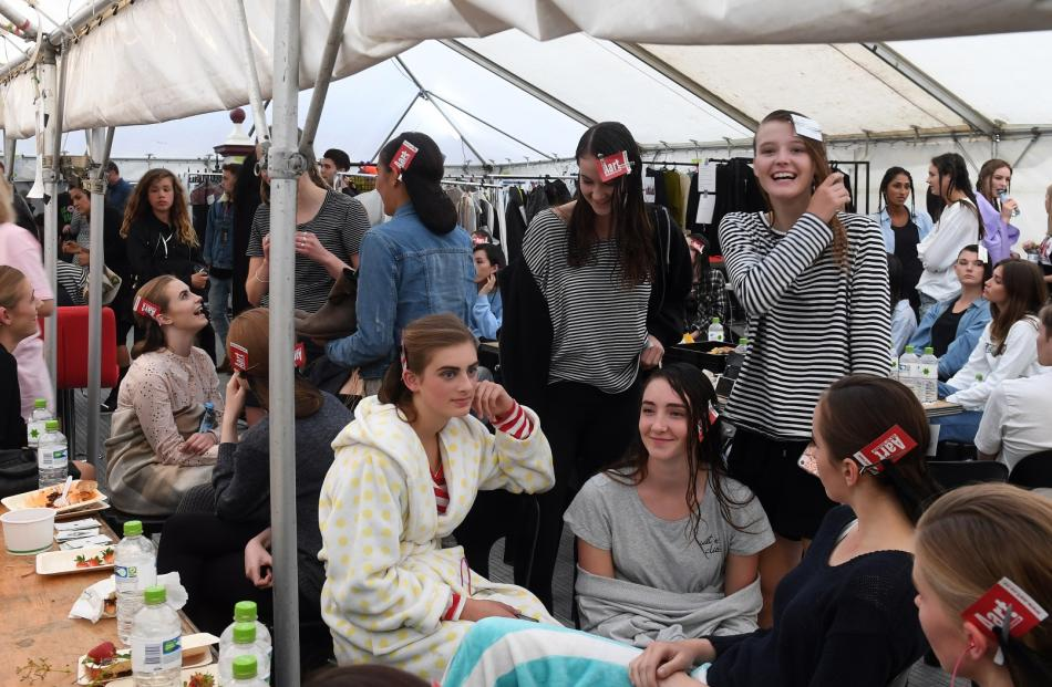 Models gather to be made up before the show.