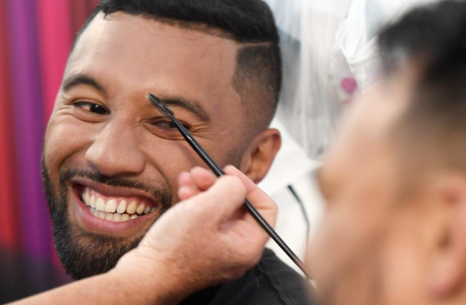 Highlander Lima Sopoaga jokes with team mate Ash Dixon as the pair get made up before the show.