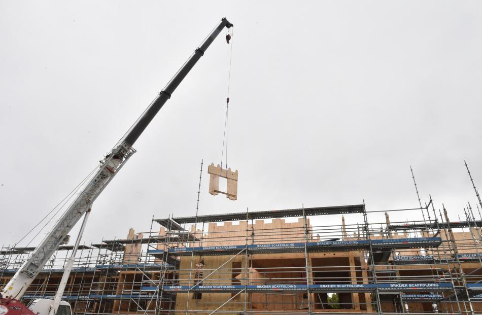 A mobile crane with a 70-tonne lifting capacity lifts a two and a-half tonne prefabricated wooden wall panel into position at the  Otago Polytechnic student village project.PHOTO: GREGOR RICHARDSON