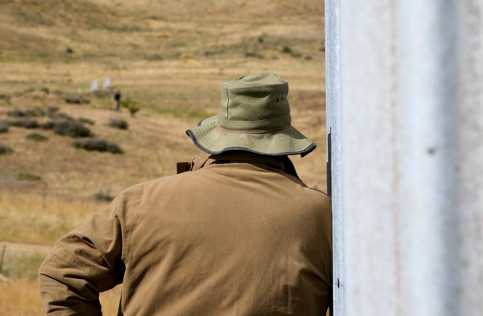 Patearoa farmer Jim Hore watches the trials.