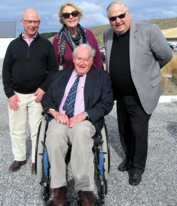 Tony Pearse (left), with Sir Tim Wallis and his wife Prue, Lady Wallis, and Clive Jermy attend the unveiling of a plaque at Wanaka Airport dedicated to the deer industry's pioneers, in 2015. Photo from ODT files.
