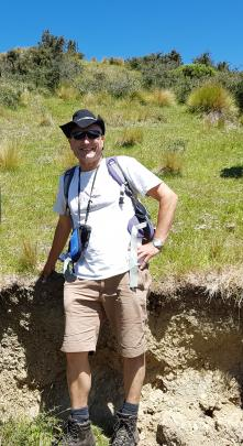 Prof Mark Stirling in front of the rupture of the Stone Jug Fault in North Canterbury. Photo:...