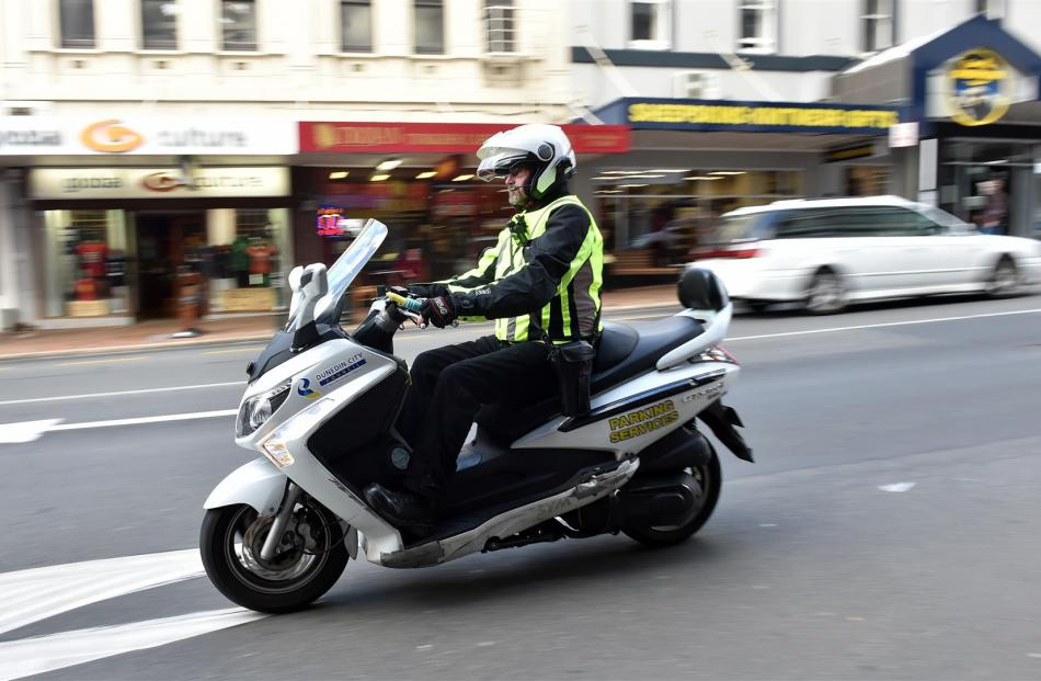 Dunedin City Council parking officer Bevan Mears wears a body camera in George St yesterday. Photos by Peter McIntosh.