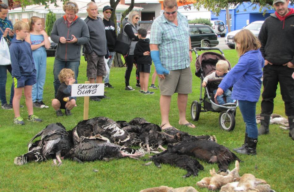 Members of the East West Bunny Boppers, of Greymouth, line up their rabbits at the end of the...