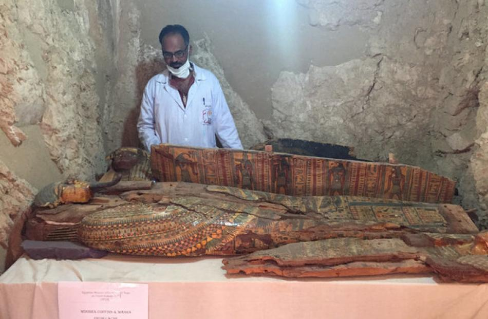An Egyptian archaeologist documents the content of the tomb of Userhat. Photo: Reuters