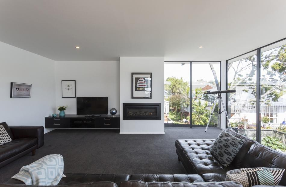 The main living area has floor-to-ceiling glazing and a green outlook: ''It's an urban site,''...