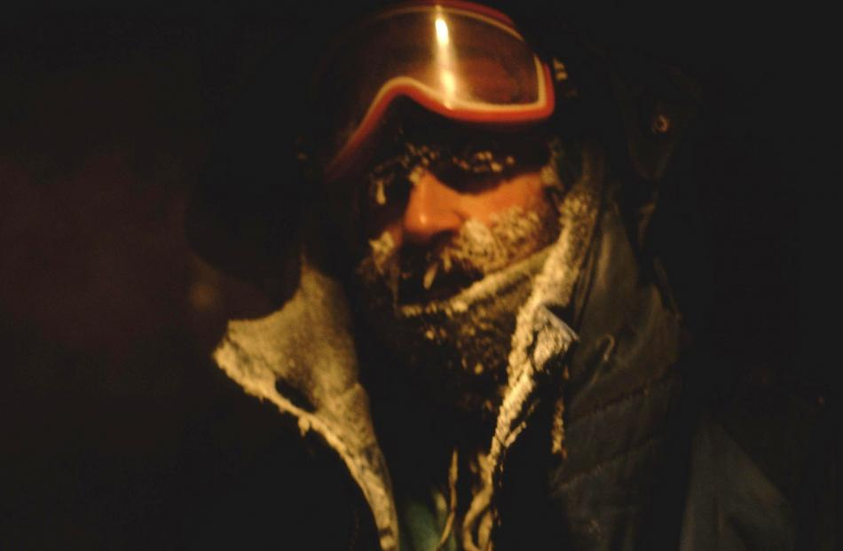Max Quinn in the middle of an Antarctic winter. Temperatures dropped as low as minus 50degC, giving him mild frostbite and jamming a camera in the five seconds it was open to the air as he changed a tape. PHOTO: DON ANDERSON
