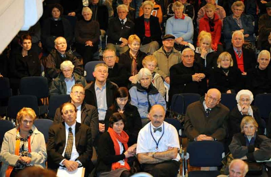 Prominent in the front row of the crowd are Invercargill mayor Tim Shadbolt (second from left)...